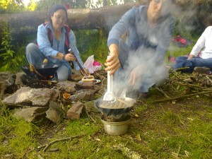 Frying sausages on the banks of the Dart.